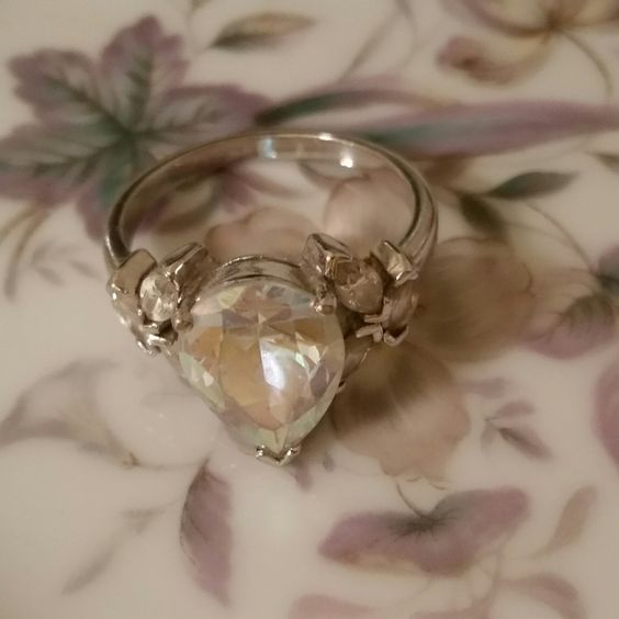 Ring silver tone with clear rhinestones and one large clear teardrop/pear