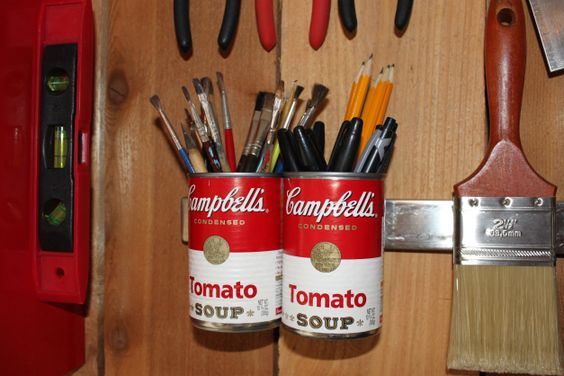 Tomato Soup Cans With Pens/Pencils. Blogger Thecavenderdiary wrote: Tomato soup cans hung on the magnet strip are the perfect place to put pens, pencils, and paint brushes. They don't really take up that much counter space, but they are just easier to find at eye-level. And yes, I choose the cans for the red color….and a slight nod to Andy Warhol.