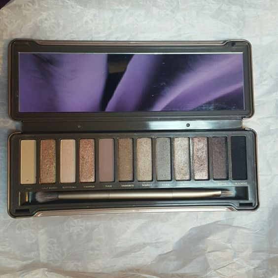 Naked Palette 2 Urban Decay, Naked Palette 2. Slightly used. Comes with original brush. Some colors not used.. Others slightly used. (I'm a makeup junkie and makeup artist.. I have bought a lot of makeup, and don't use it all.. Hoping someone else can put it to use) Urban Decay Makeup Eyeshadow