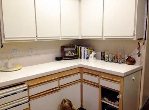 Easy way to update the 80's kitchen. Paint the wood trim to match ...