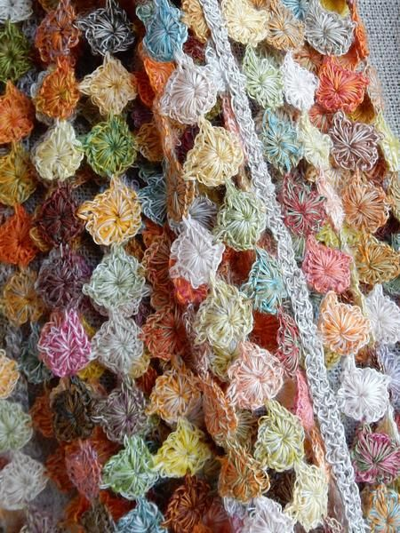 "Teeny tiny pastilles of hand crocheted linen for this 12 x 52 inch scarf ""Rikiki""."