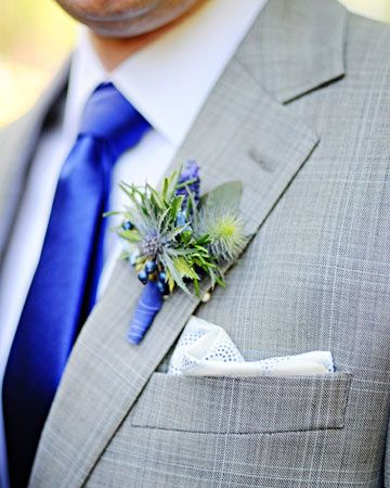 Grey suite with cobalt blue tie.