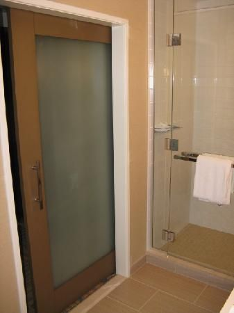 Glass pocket doors pocket doors and frosted glass on pinterest for Bathroom vanity with frosted glass doors