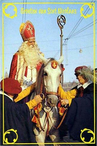 Sinterklaas op schimmel, twee paardenknechten.