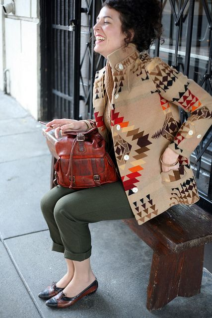 Patterned vintage coat with classic brown and black flats.  She knows what she is doing.