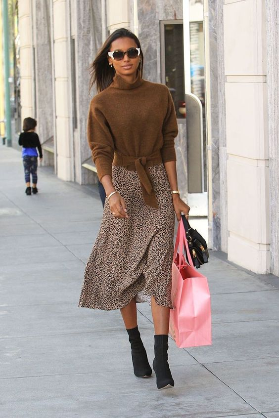 Jasmine Tookes sweater and leopard skirt with black ankle boots