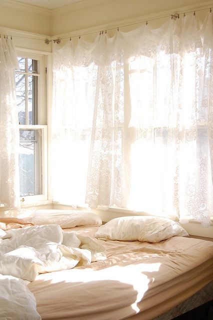 Sunshine filtered through lace curtains