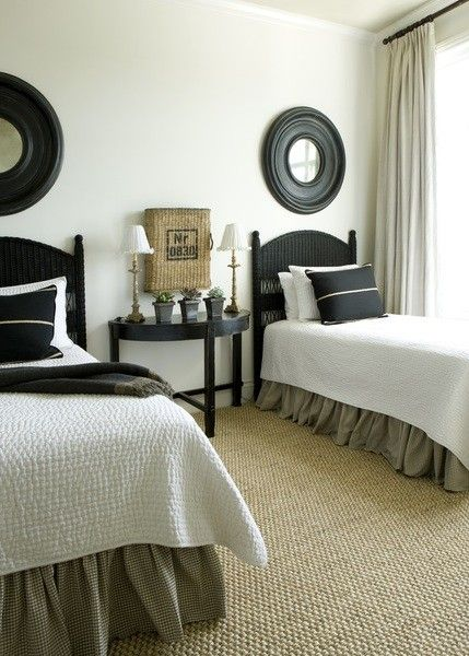 Perfect guest room:  love the neutral palette (cream + black); symmetry of black headboards + mirrors; sisal rug; black pillows