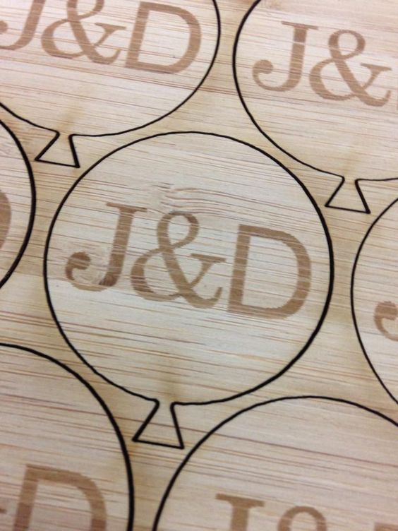 Laser cut wedding tags for the flower vases