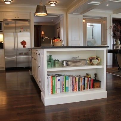 Add a bookshelf to the end of an island for cookbooks..