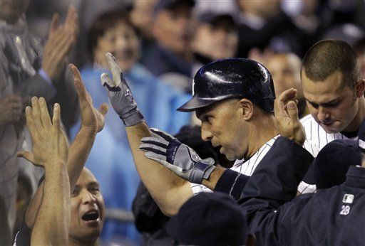 GAME 29: Tuesday, May 8, 2012 - New York Yankees Russell Martin, lower left, greets Raul Ibanez who hit a seventh-inning solo home run, his second of the game, during the Yankees baseball game against the Tampa Bay Rays at Yankee Stadium in New York. (AP Photo/Kathy Willens):