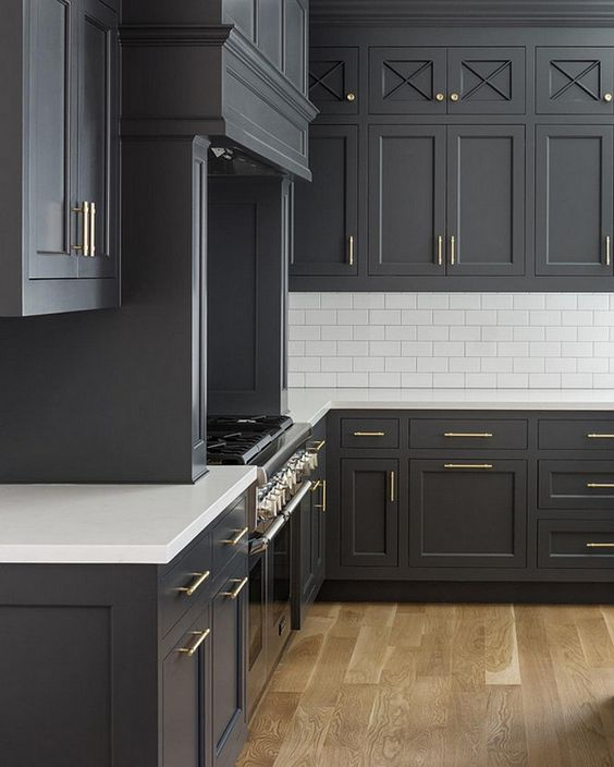 Grey and white classic timeless kitchen by The Fox Group. Come be inspired by more Timeless Interior Design Ideas, Paint Colors & Furniture. #thefoxgroup #benjaminmoorecheatingheart #kitchendesign #greycabinets #subwaytile #greyandwhitekitchen