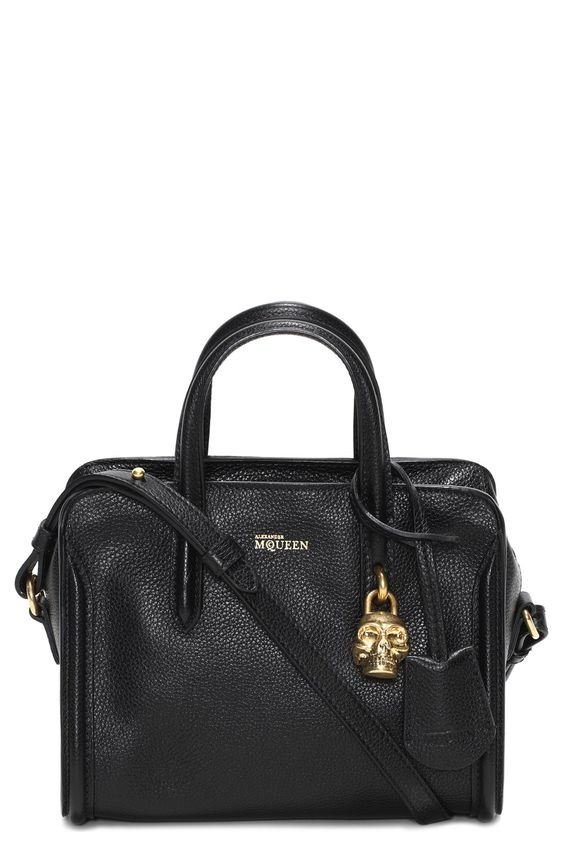 Infatuated with this Alexander McQueen leather duffel bag and its signature skull padlock.