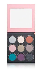 """The first thing that caught my eye about this palette was the packaging. It was sexy and fun! The shades all have amazing pay off with loads of shimmer. I use soft colors like """"Envious Erin"""" to highlight under my brow and """"Come-Hither Heather"""" on my lid for a soft shimmer. This palette is full of vibrant colors. It is a great size for travel and having a mirror is an awesome bonus. Overall, I think this is a great palette and I look forward to using it more."""