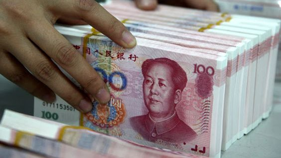 Is the Yuan About to Become A Reserve Currency?: What does the Chinese currency's upgrade mean for the U.S. dollar?