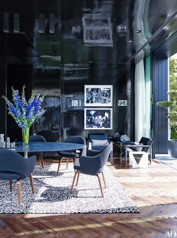 In Alex Rodriguez's high-gloss office, a Florence Knoll pedestal table is grouped with Saarinen armchairs, all by Knoll, and a carpet by Diane von Furstenberg for the Rug Company. | archdigest.com