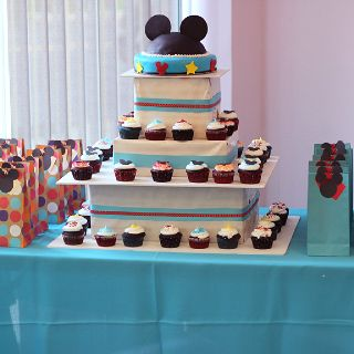 Mickey mouse cake,cupcakes and treat bags.
