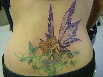 I can almost see something like this one for my next tatt - I like the idea but would have a different artwork but still a fairy on greenery
