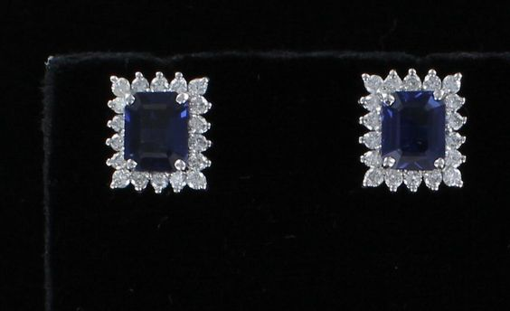 14KT SAPPHIRE AND DIAMOND EARRINGS VIBRANT MEDIUM BLUE EMERALD-CUT SAPPHIRES ARE THE CENTERPIECE OF THESE MAGNIFICENT 14KT WHITE GOLD EARRINGS. THE TOTAL WEIGHT OF THE SAPPHIRES IS 6.17 CT, AND THEY ARE TRIMMED WITH SPARKLING WHITE DIAMONDS. THESE LUSCIOUS EARRINGS ARE APPROXIMATELY 5/8 INCH LONG AND 1/12 INCH WIDE AND ARE ON A POST.  $5,500