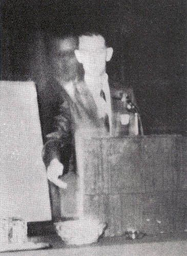 This photo was taken on November 16, 1968 when Robert A. Ferguson, author of Psychic Telemetry: New Key to Health, Wealth, and Perfect Living, was giving a speech at a Spiritualist convention in Los Angeles, California. Faintly appearing next to Ferguson is a figure that he later identified as his brother, Walter, who died in 1944 during World War II.  More paranormal locations at: http://www.panicd.com