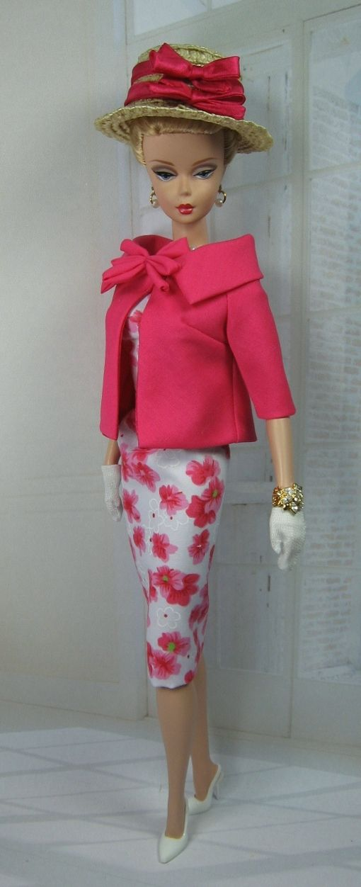 Silkstone Barbie... in a glamorous floral dress with a sassy melon color jacket. Topped off with a straw hat with matching melon color bows... Fashion by Matisse