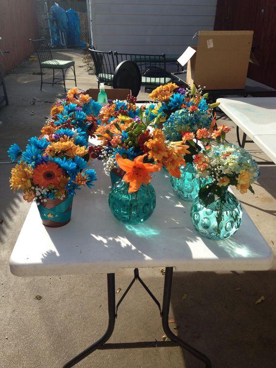 Flower centerpieces turquoise and orange centerpiece