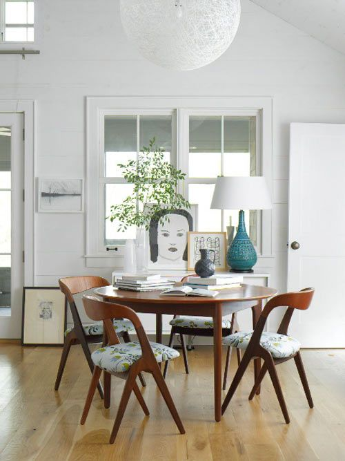 Amie Weitzman's Connecticut cottage. Dining area with vintage chairs upholstered in Lulu DK fabric. The pendant lamp is from Design Within Reach.