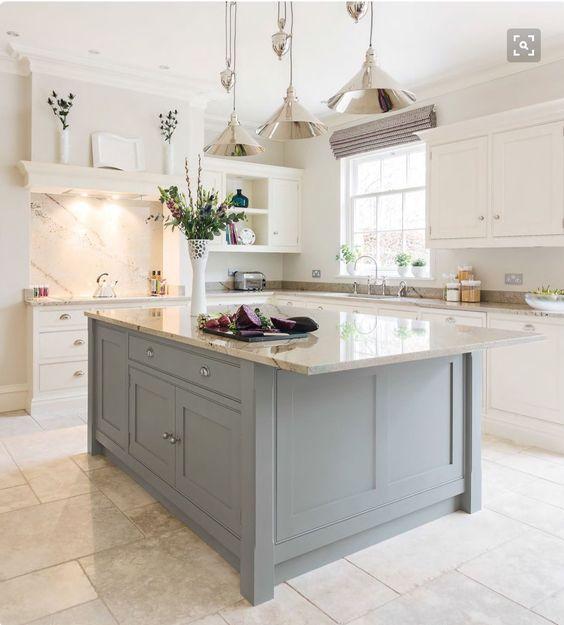 Best White Kitchens Design Ideas {Photos We Can't Stop Pinning!} Beautiful white kitchen with travertine tile floor, shiny nickel pendants, white countertops and timeless style. #whitekitchen #travertine #interiordesign