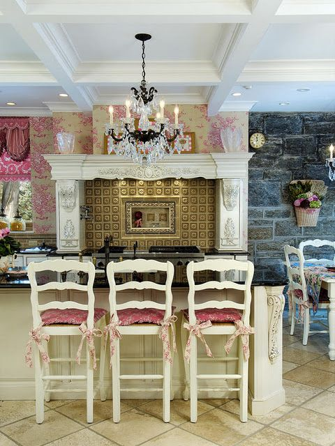French kitchen...love the stone wall in the dining area!