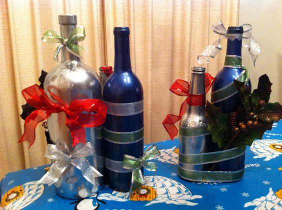Christmas centerpieces made by my sister and I. All you need is beer&wine bottles, spray paint, ribbon and other decorative things to glue on. Use hot glue. Glue all the bottles together so it won't fall apart. (Pic1)