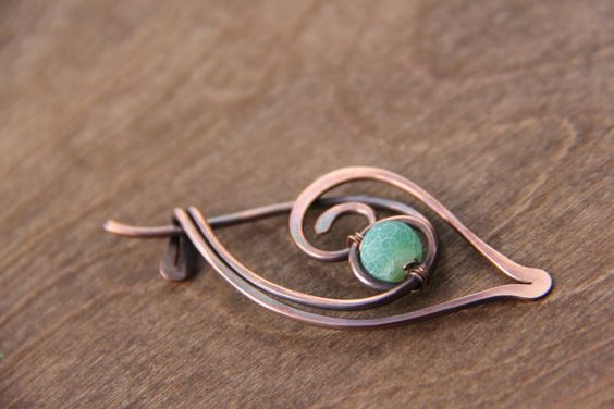 Smaller shawl pin on simple side featuring tender green etched agate. It measures about 2 1/2 in length. Brooch is light weight and versatile. Like all of my items it is completely hand shaped, hammered, oxidized and hand polished.  ***Metal has bare finish, so some darkening will occur with time, so the best way to keep it away from moisture. and high humidity. However shine can be restored by polishing with jewelry polishing cloth. ***It will arrive in zip lock bag with anti tarnishing…