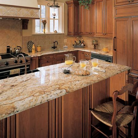 This looks like an old style vineyard kitchen and the colonial granite makes it even more so. Paired with similar style tiles, you've got your very old Italian villa.