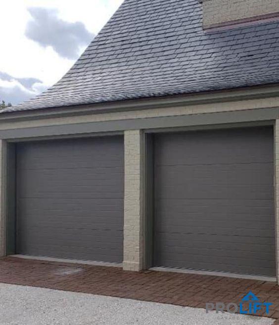 Choosing A New Garage Door Here S What Homeowners Need To Know In 2020 Garage Door Styles Grey Garage Doors Garage Door Types