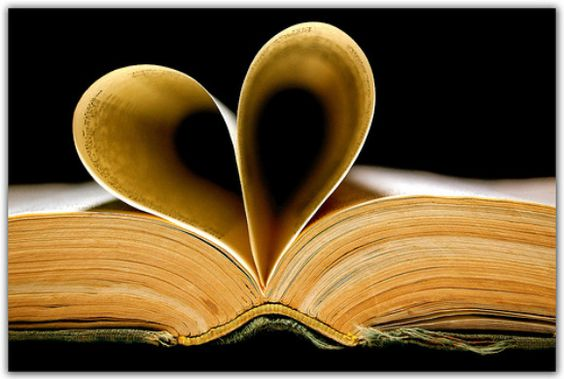 Book with heart shaped pages. Love is....