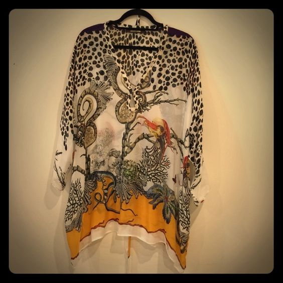 Timeless Roberto Cavalli print top with tie belt. Gorgeous multi color silk top. Neutral in colors. Perfect length for pants, shorts or a skirt. Perfect as a bathing suit cover up! Roberto Cavalli Tops