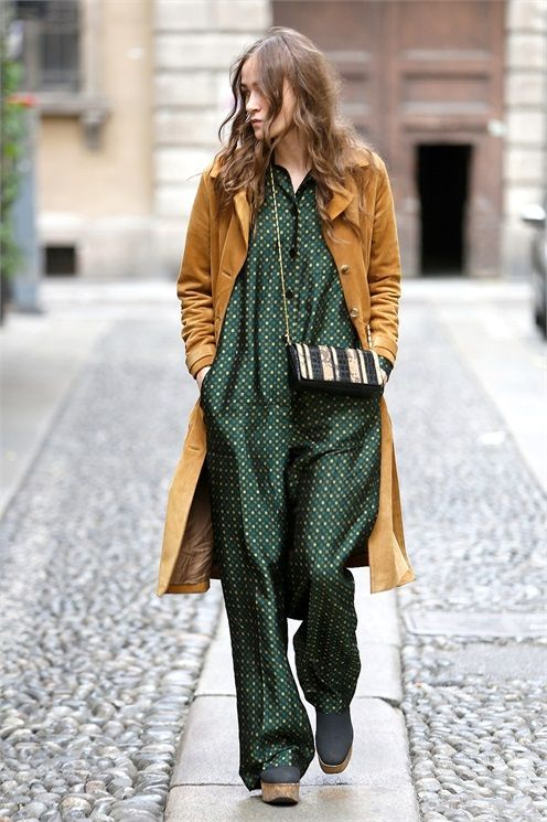 Oversized green jumpsuit with a camel jacket and small black and white stripe cross body bag | Image via vogue.it