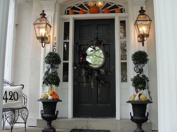 pumpkins over the door and in the urn