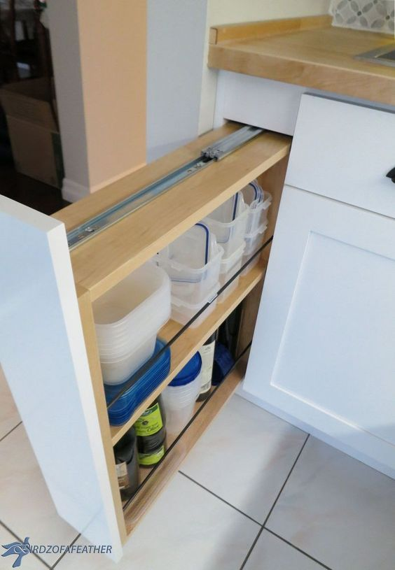 Hidden kitchen storage turn a filler panel into a pull out for Hidden kitchen storage ideas