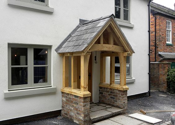 Oak porch on rendered cottage