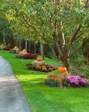 Outdoor Fall Decorating with mums, hay bales, and pumpkins.