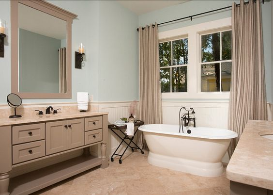 The walls are Rainwash Sherwin Williams SW6211 and the vanities ...