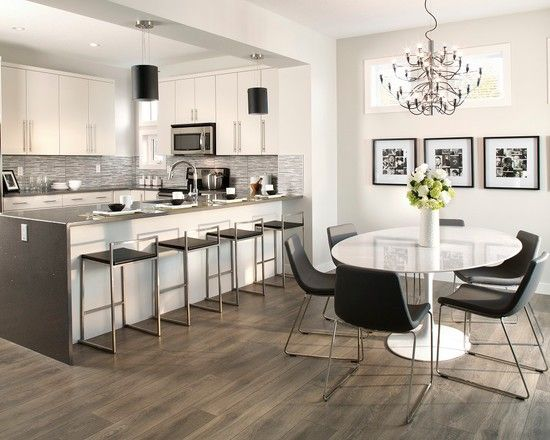 gorgeous dark wood laminate flooring white kitchen cabinet white round dining table with black chairs gray tabletop with chairs chandelier wall art gallery