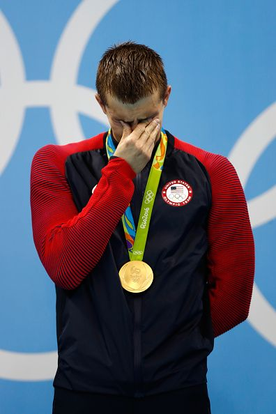 Gold medalist Ryan Held of the United States shows his emotion on the podium during the medal ceremony for the Final of the Men's 4 x 100m…