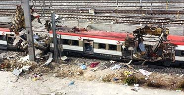 Destroyed railway carriages sit on the tracks after a bomb exploded in the Atocha railway station in Madrid, Spain March 2004.  It was later found to be a terrorist attack