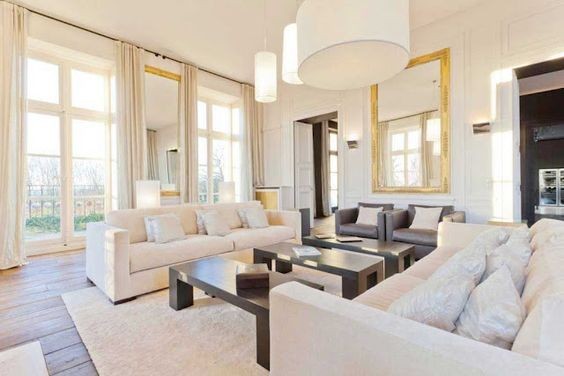 Three coffee tables in this modern living room in a French chateau! http://cococozy.com