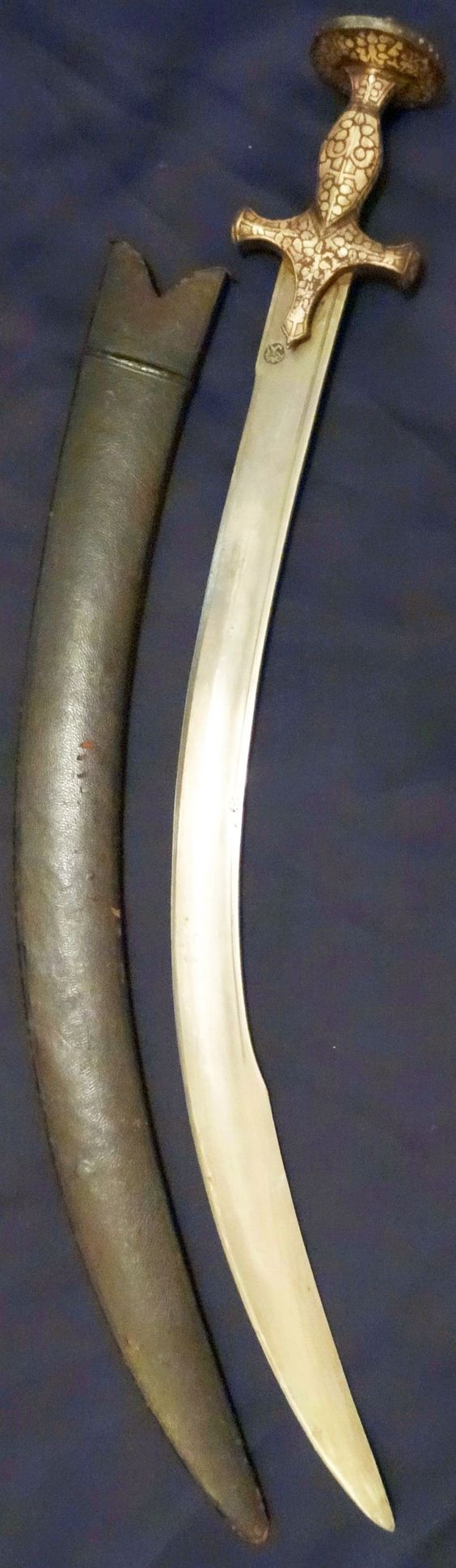 Tegha/pala style short sword from India. Probably mid 19 C. Deeply curved.