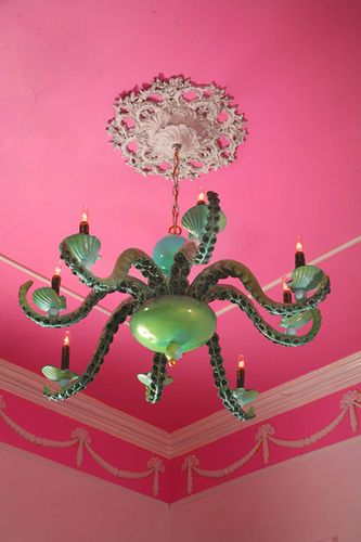 How very quirky and fun! It works especially well with the Pepto-bismol pink ceiling and walls, and the pink swags.