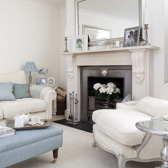 white walls, pastel blue, gray and white furniture