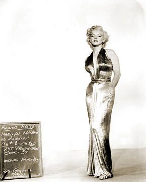marilyn in gold lame dress designed by William Travilla