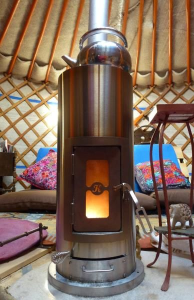This is a Kimberly stove, developed in the US for use in camper vans, boats and Yurts. It has a really small foot print, so you can squeeze it anywhere and it's super cool looking.